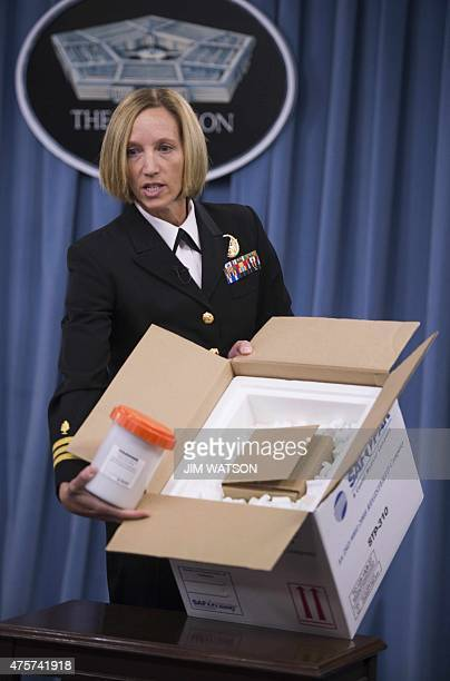 Director of Medical Programs for DoD Chemical and Biological Defense Commander Franca Jones shows how Anthrax is shipped to the labs during a media...