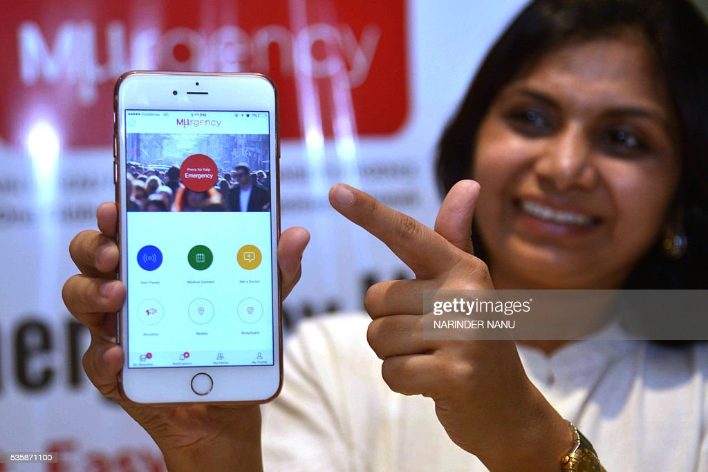 Director of MUrgency Inc. Sweta Mangal(C) launches a mobile 'App' in Amritsar on May 30, 2016, aimed at those in a medical emergency. The free cloud based app will connect people who need medical help with their trusted network and with medically trained and credentialed responders such as Doctors, Nurses, EMTs and Paramedics in their locality with just one tap on a mobile phone. / AFP / NARINDER