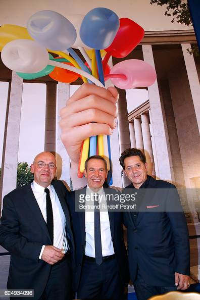 Director of 'Musee d'Art Moderne de la Ville de Paris' Fabrice Hergott Artist Jeff Koons and Palais de Tokyo President Jean De Loisy attend the Press...