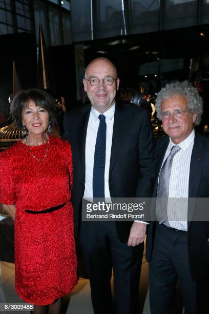 Director of 'Musee d'Art Moderne de la Ville de Paris' Fabrice Hergott pose between Laurent Dassault and his wife Martine pose in front the works of...