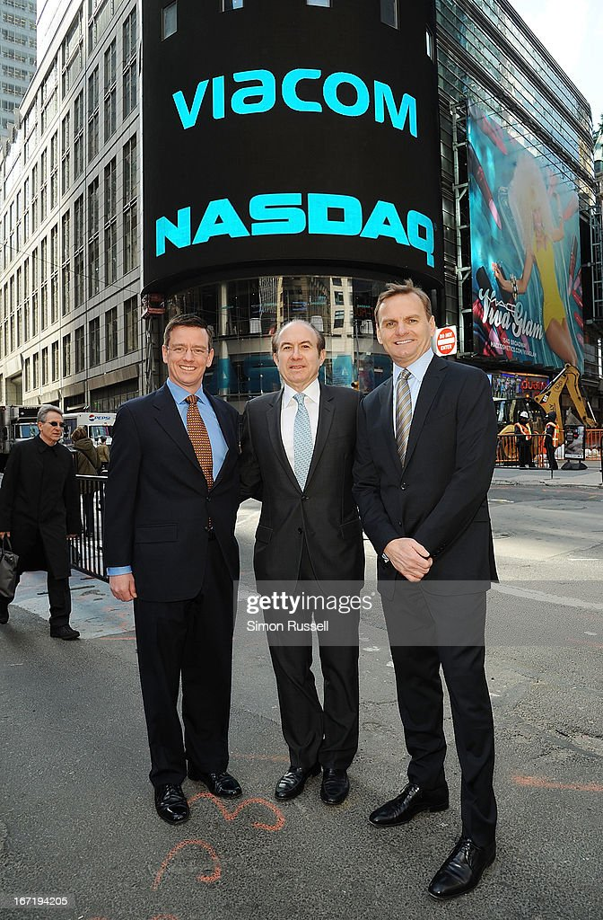 Director of NASDAQ Robert Phillips, Viacom President & CEO <a gi-track='captionPersonalityLinkClicked' href=/galleries/search?phrase=Philippe+Dauman&family=editorial&specificpeople=1381252 ng-click='$event.stopPropagation()'>Philippe Dauman</a> and NASDAQ EVP Bruce Aust ring the NASDAQ Stock Market opening bell in honor of Viacommunity Day at the NASDAQ MarketSite on April 22, 2013 in New York City.