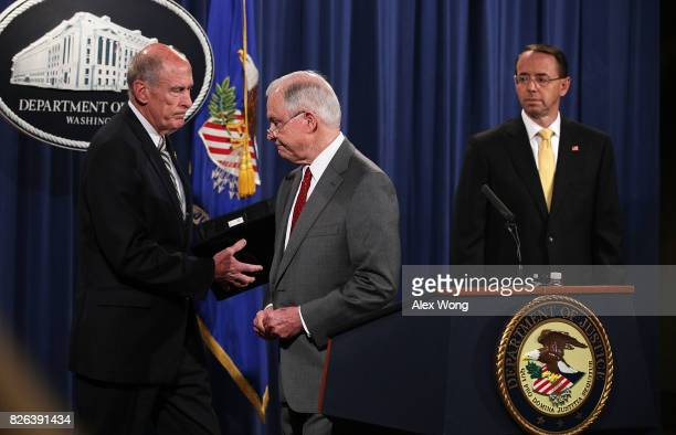 US Director of National Intelligence Dan Coats Attorney General Jeff Sessions and Deputy Attorney General Rod Rosenstein attend an event at the...