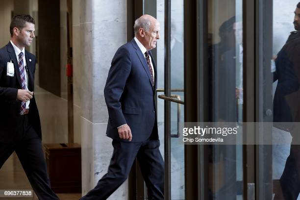 S Director of National Intelligence Dan Coats leaves the Hart Senate Office Building after meeting behind closed doors with members of the Senate...