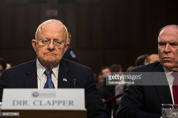 WASHINGTON DC FEBRUARY Director of National Intelligence James Clapper and CIA Director John Brennan wait for the Senate Intelligence Committee...