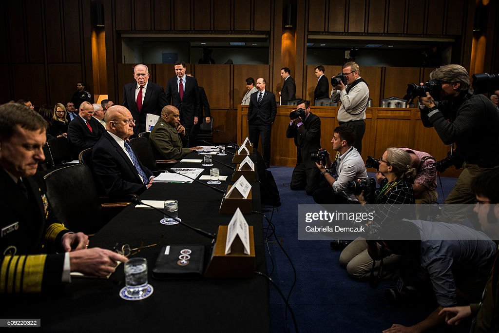 Director of National Intelligence James Clapper and other witnesses take their seat before the Senate (Select) Intelligence Committee hearing at the Hart Senate Building on February 9, 2016 in Washington, D.C. The committee met to hear testimony about worldwide threats to America and its allies.