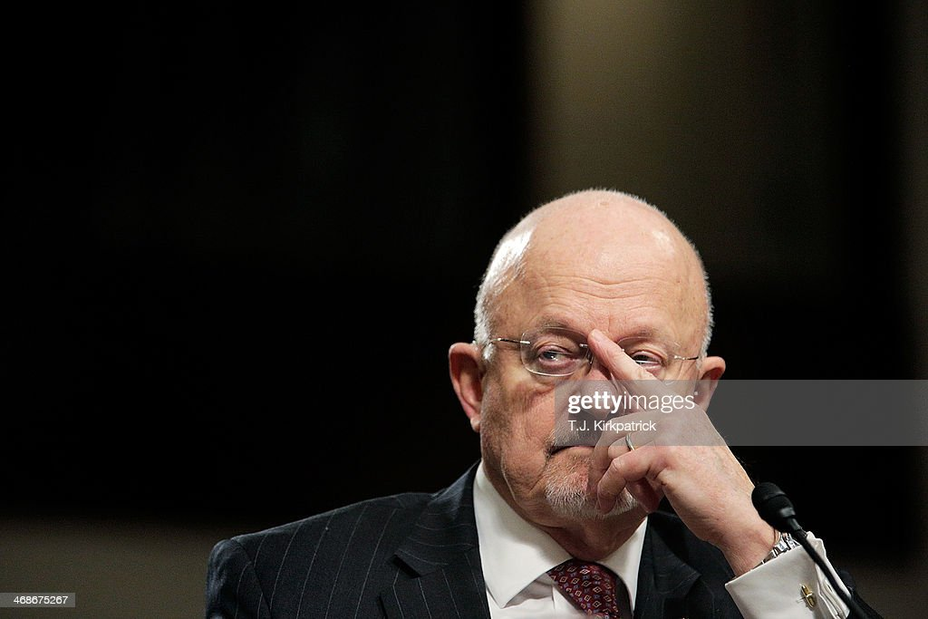 Director of National Intelligence James Clapper Jr pushes up his glasses while testifying before the Senate Armed Services Committee on February 11...