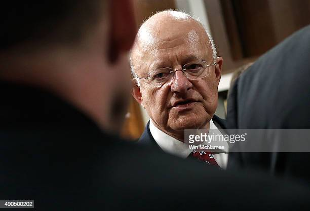 Director of National Intelligence James Clapper speaks with colleagues prior to testifying before the Senate Armed Services Committee September 29...