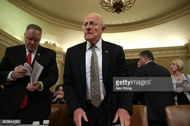 Director of National Intelligence James Clapper takes his seat as he arrives at a hearing before the House Intelligence Committee November 17 2016 on...