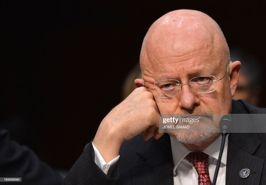Director of National Intelligence James Clapper testifies before a full committee hearing on 'Current and Projected National Security Threats to the United States'at the Hart Senate Office Building in Washington, DC, on March 12, 2013. AFP PHOTO/Jewel Samad