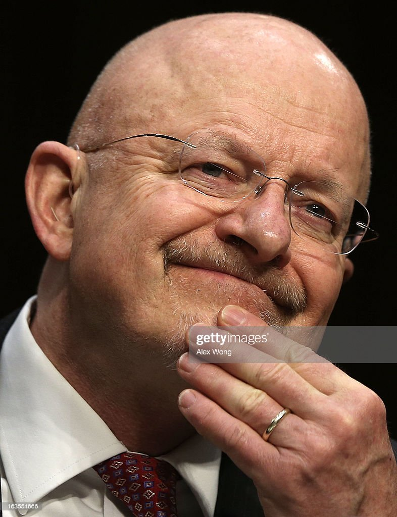 Director of National Intelligence James Clapper testifies during a hearing before the Senate (Select) Intelligence Committee March 12, 2013 on Capitol Hill in Washington, DC. The committee held a hearing on 'Current and Projected National Security Threats to the United States.'