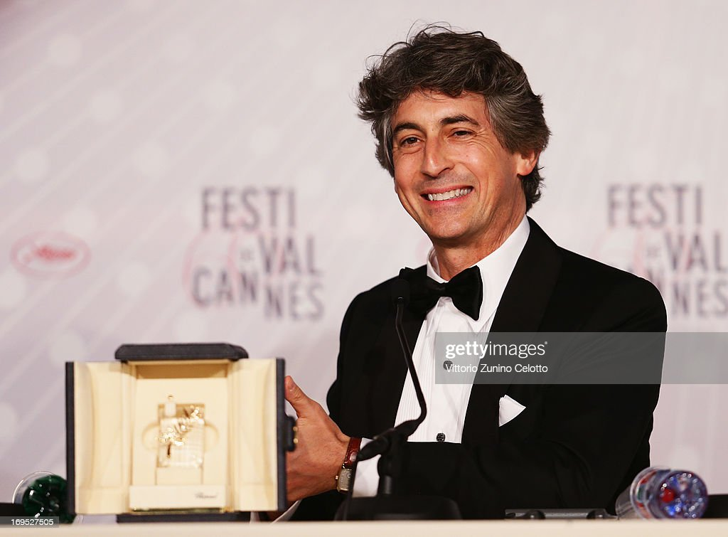 Director of 'Nebraska' Alexander Payne, holding Bruce Dern's 'Prix D'Interpretation Masculine' (Best Performance by an Actor award), onstage at the Palme D'Or Winners Press Conference during the 66th Annual Cannes Film Festival at the Palais des Festivals on May 26, 2013 in Cannes, France.