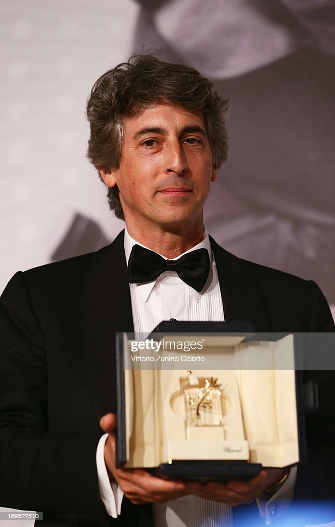 Director of 'Nebraska' <a gi-track='captionPersonalityLinkClicked' href=/galleries/search?phrase=Alexander+Payne&family=editorial&specificpeople=202578 ng-click='$event.stopPropagation()'>Alexander Payne</a>, holding Bruce Dern's 'Prix D'Interpretation Masculine' (Best Performance by an Actor award), onstage at the Palme D'Or Winners Press Conference during the 66th Annual Cannes Film Festival at the Palais des Festivals on May 26, 2013 in Cannes, France.