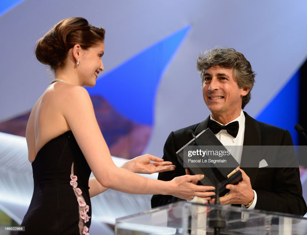 Director of 'Nebraska' Alexander Payne receives the 'Prix D'Interpretation Masculine' (Best Performance by an Actor) on behalf of Bruce Dern for his performance in 'Nebraska' from actress Laetitia Casta (L) during the Inside Closing Ceremony during the 66th Annual Cannes Film Festival at the Palais des Festivals on May 26, 2013 in Cannes, France.