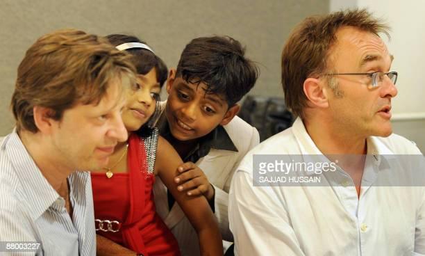 Director of Oscar winning movie 'Slumdog Millionaire' Danny Boyle producer Christian Colson child stars of the film Mohammad Azharuddin and Rubina...