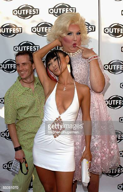 Director of Outfest 2005 Stephen Gutwillig personality Moma and actress Bai Ling arrive at the Outfest 2005 Awards Night on July 17 2005 at the John...