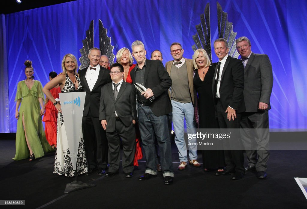 Director of outstanding film 'Any Day Now', Travis Fine (center, with cast) accepts the 24th Annual GLAAD Media Awards at the Hilton San Francisco - Union Square on May 11, 2013 in San Francisco, California.