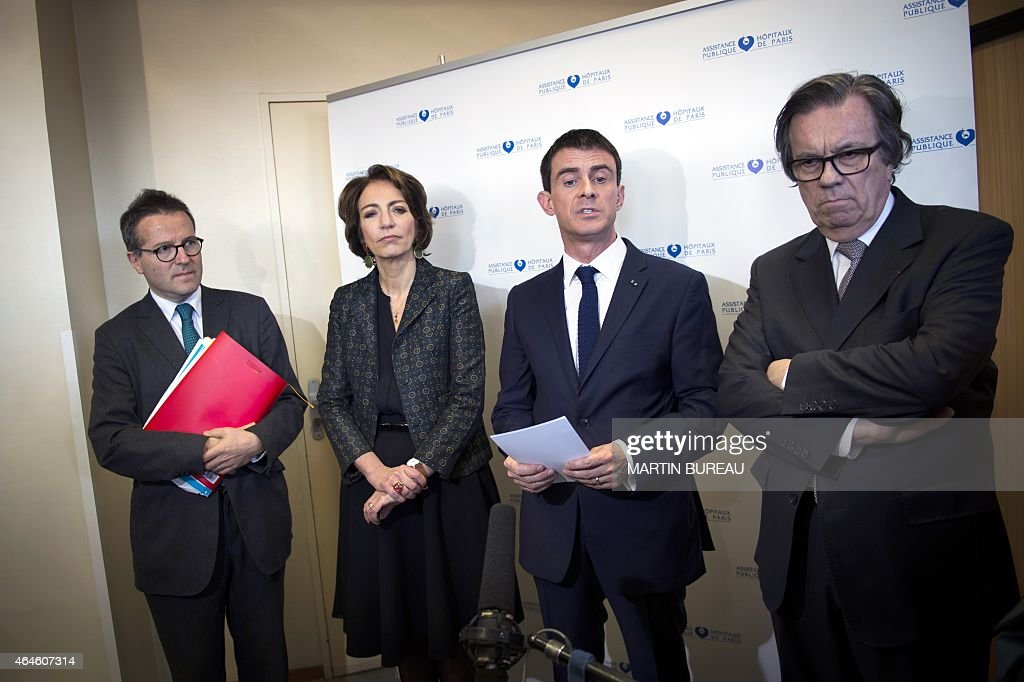 Director of Paris' public assistance hospitals AP-HP <a gi-track='captionPersonalityLinkClicked' href=/galleries/search?phrase=Martin+Hirsch&family=editorial&specificpeople=2273261 ng-click='$event.stopPropagation()'>Martin Hirsch</a>, French minister for Social Affairs, Health and Women's Rights Marisol Touraine, French Prime Minister <a gi-track='captionPersonalityLinkClicked' href=/galleries/search?phrase=Manuel+Valls&family=editorial&specificpeople=2178864 ng-click='$event.stopPropagation()'>Manuel Valls</a> and President of the Ile-de-France region Health authority, Claude Evin, give a press conference after their visit of La Pitie Salpetriere hospital, on February 27, 2015 in Paris, as France is facing the worst flu epidemic of the past five years.