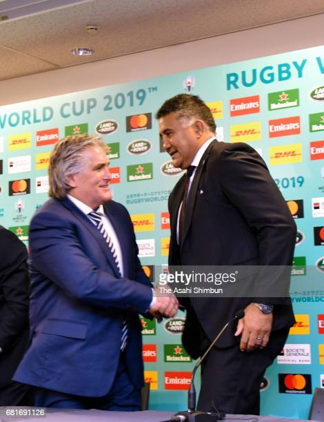 RU Director of Performance Scott Johnson of Scottland and Jamie Joseph head coach of Japan shake hands during a press conference after the Rugby...