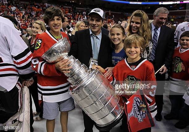 Director of Player Personnel Marc Bergevin hoists the Stanley Cup after the Blackhawks defeated the Philadelphia Flyers 43 in overtime to win the...