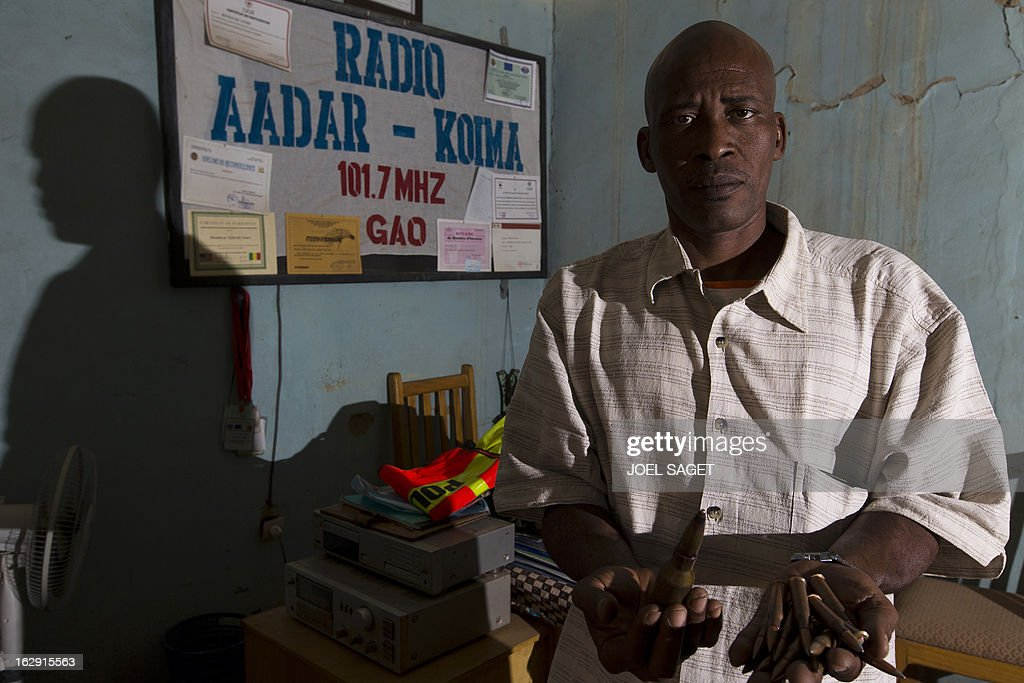 COZ --- Director of radio AADAR-Koima programmes Souleima Maiga holds munitons found in Gao on February 28, 2013. Gao, the main town in northern Mali, which is also the most resilient to the law imposed for ten months by Tuareg rebels and then by armed Islamists, is supported by a handful of Radio presenters, technicians and managers. The trouble began at the end of March for community radio AADAR-Koima when Tuareg rebels of the National Movement for the Liberation of Azawad (MNLA) invaded the city. By the end of June, under the domination of Mujao (Movement for Oneness and Jihad in West Africa), 'we had to stop the music and broadcast messages calling for adherence to religious movements,' said Maiga.