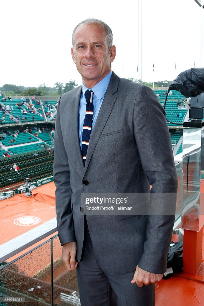 Director of Roland Garros tournament, <a gi-track='captionPersonalityLinkClicked' href=/galleries/search?phrase=Guy+Forget&family=editorial&specificpeople=235573 ng-click='$event.stopPropagation()'>Guy Forget</a> poses at France Television french chanel studio during a rainny Day Ten of the 2016 French Tennis Open at Roland Garros on May 31, 2016 in Paris, France.