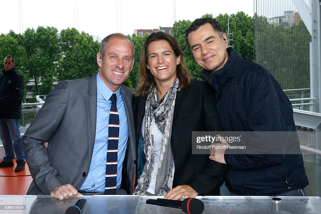 Director of Roland Garros tournament, <a gi-track='captionPersonalityLinkClicked' href=/galleries/search?phrase=Guy+Forget&family=editorial&specificpeople=235573 ng-click='$event.stopPropagation()'>Guy Forget</a>, Presenter of Roland garros <a gi-track='captionPersonalityLinkClicked' href=/galleries/search?phrase=Amelie+Mauresmo&family=editorial&specificpeople=161389 ng-click='$event.stopPropagation()'>Amelie Mauresmo</a> and Sports journalist Laurent Luyat pose at France Television french chanel studio during a rainny Day Ten of the 2016 French Tennis Open at Roland Garros on May 31, 2016 in Paris, France.