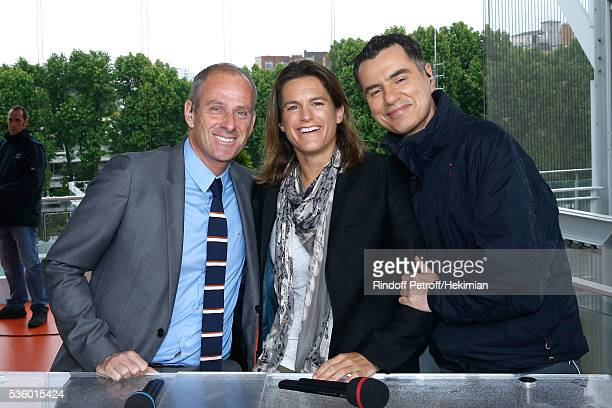 Director of Roland Garros tournament Guy Forget Presenter of Roland garros Amelie Mauresmo and Sports journalist Laurent Luyat pose at France...