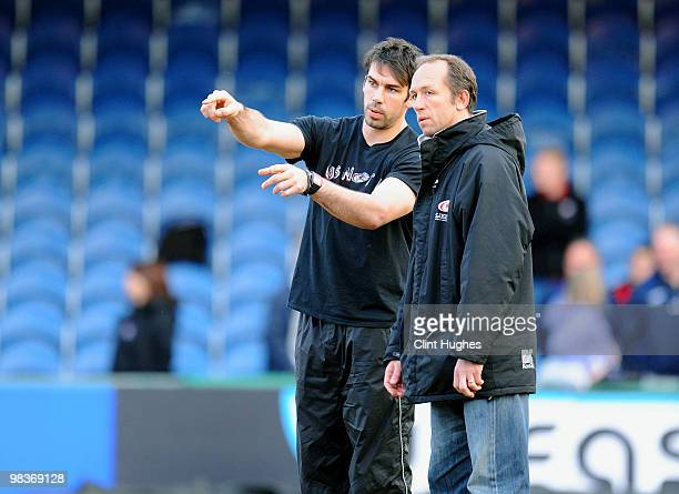 Director of Rugby Brendon Venter and forwards coach Alex Sanderson of Saracens during the Guinness Premiership match between Sale Sharks and Saracens...