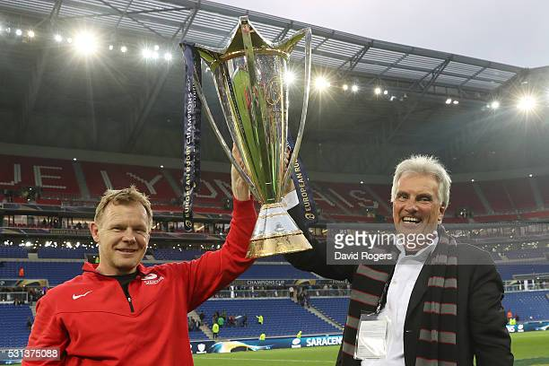 Director of Rugby Mark McCall and owner Nigel Wray of Saracens pose with the trophy after the European Rugby Champions Cup Final match between Racing...