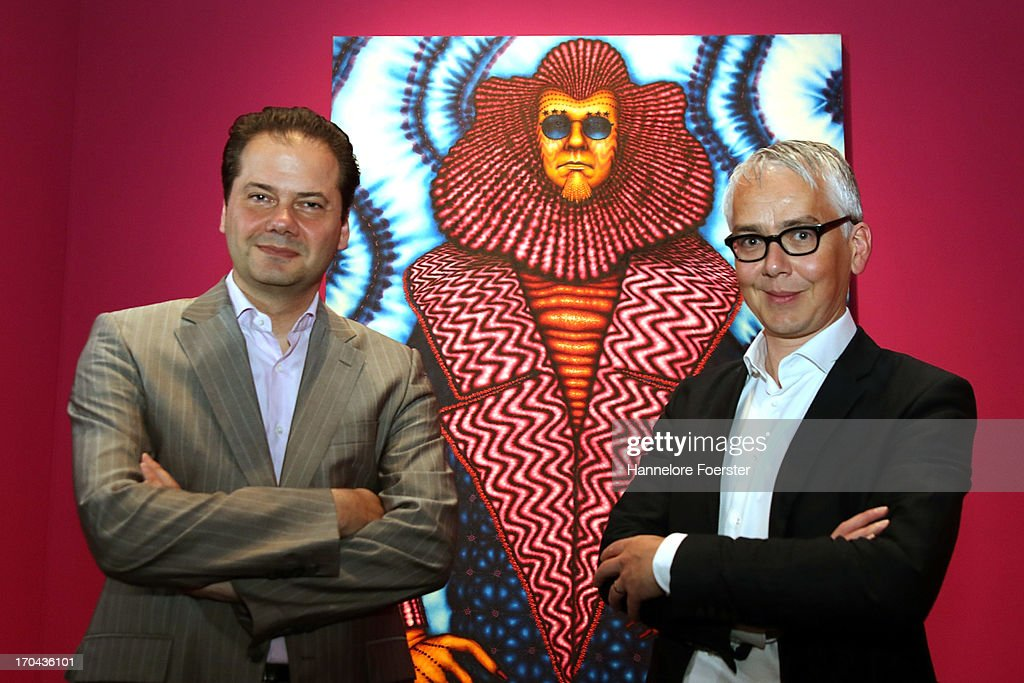 Director of Schirn Kunsthalle Max Hollein and Exhibitions and Displays Curator Darren Pih of Tate Liverpool pose in front of an Ed Paschle picture, during the GLAM-Exhibition at Schirn Kunsthalle on June 13, 2013 in Frankfurt am Main, Germany.