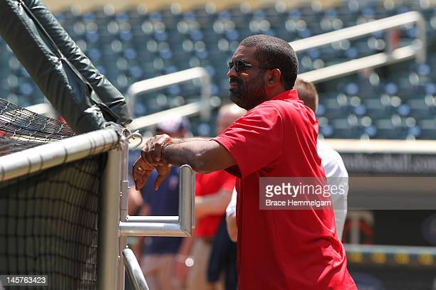 Director of scouting Deron Johnson of the Minnesota Twins watches potential draft picks work out on June 2 2012 at Target Field in Minneapolis...