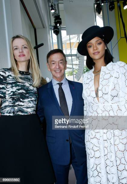 Director of sponsorship LVMH JeanPaul Claverie standing between Singer Rihanna and President of the Jury of the Prize Louis Vuitton's executive vice...
