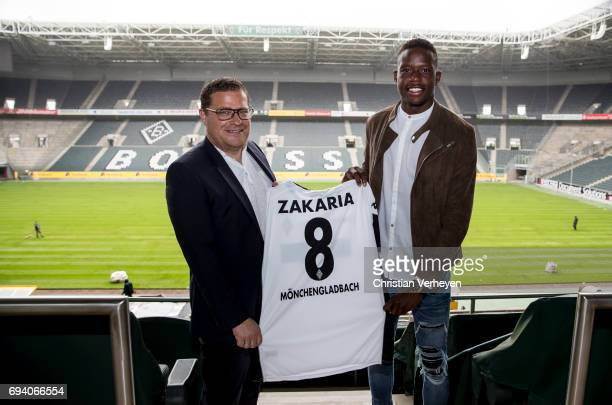 Director of Sport Max Eberl and Denis Zakaria pose with his new jersey after signing a contract with Borussia Moenchengladbach at BorussiaPark on...