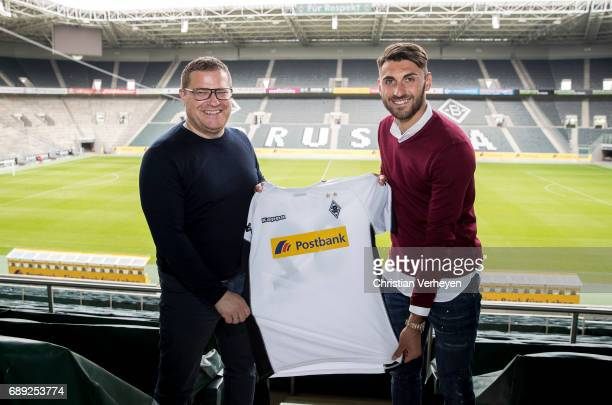 Director of Sport Max Eberl and Vincenzo Grifo pose with the new jersey after siginig a new contract with Borussia Moenchengladbach at BorussiaPark...