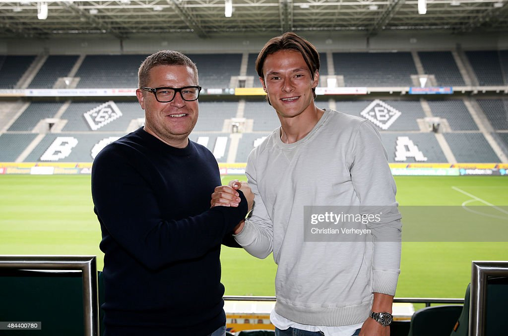 Director of Sport Max Eberl of Borussia Moenchengladbach and Nico Schulz after he signs a new contract for Borussia Moenchengladbach on Augsut 18, 2015 at BORUSSIA-PARK, Moenchengladbach, Germany.