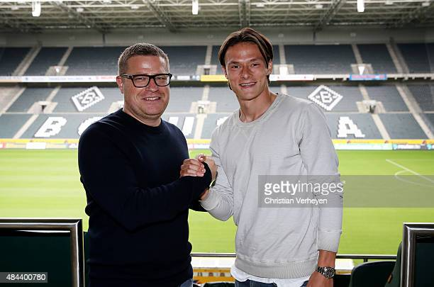 Director of Sport Max Eberl of Borussia Moenchengladbach and Nico Schulz after he signs a new contract for Borussia Moenchengladbach on Augsut 18...