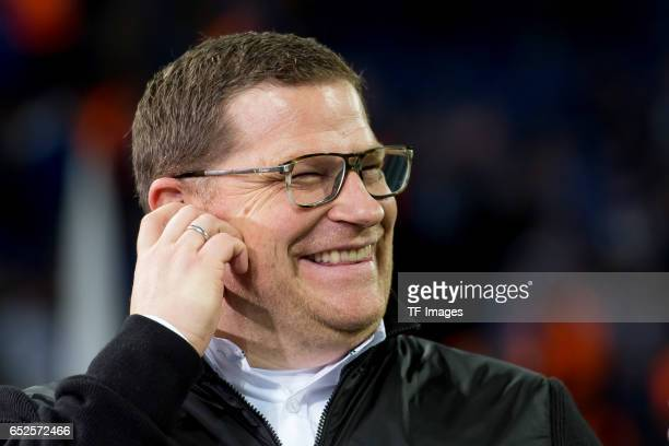 Director of Sport Max Eberl of Borussia Moenchengladbach laughs during the UEFA Europa League Round of 16 first leg match between FC Schalke 04 and...
