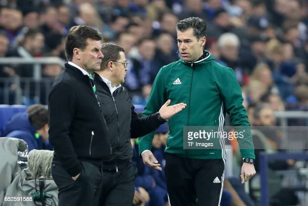Director of Sport Max Eberl of Borussia Moenchengladbach speak with Charles Schaap during the UEFA Europa League Round of 16 first leg match between...