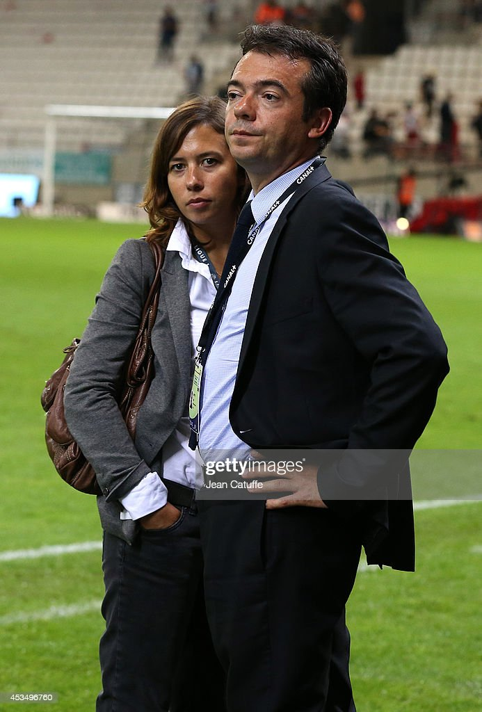 Director of Sports at Canal Plus Cyril Linette and Press officer for the Euro 2016 Lola Bourget look on after the French Ligue 1 match between Stade de Reims and Paris Saint Germain FC at the Stade Auguste Delaune on August 8, 2014 in Reims, France.