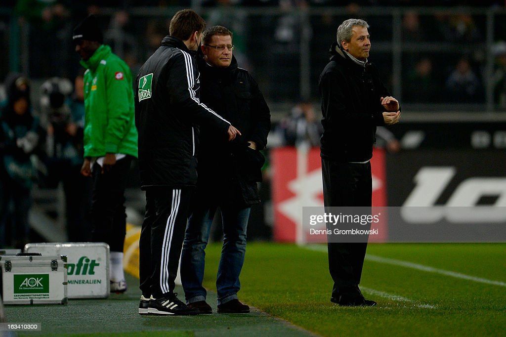 Director of sports Martin Eberl of Moenchengladbach discusses with fourth official Frank Willenborg during the Bundesliga match between VfL Borussia Moenchengladbach and SV Werder Bremen at Borussia Park Stadium on March 9, 2013 in Moenchengladbach, Germany.