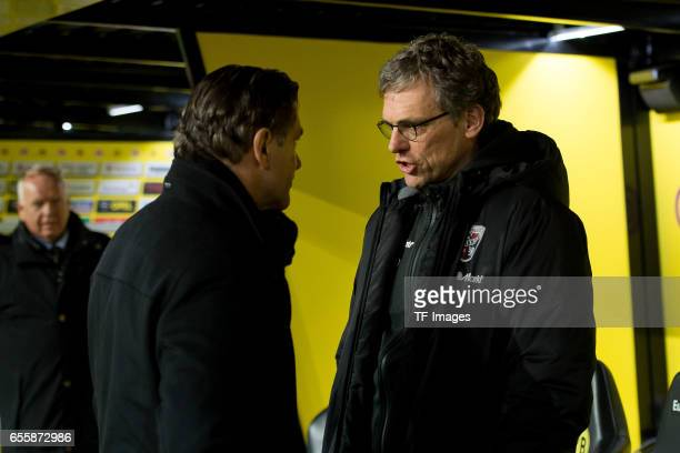 Director of Sports Michael Zorc of Dortmund and CoHead coach Michael Henke of Ingolstadt looks on during the Bundesliga match between Borussia...