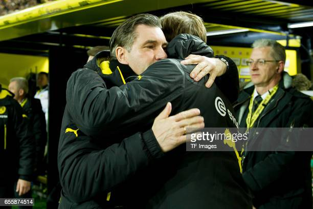 Director of Sports Michael Zorc of Dortmund shakes hands with Head coach Thomas Tuchel of Dortmund during the Bundesliga match between Borussia...