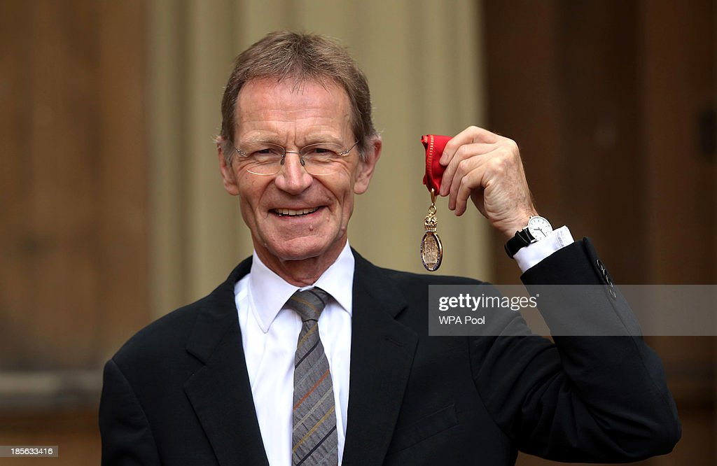 Director of Tate Sir Nicholas Serota holds his medal after being made a Member of the Order of Companions of Honour by the Prince of Wales during an Investiture ceremony on October 23, 2013 at Buckingham Palace, London, England.