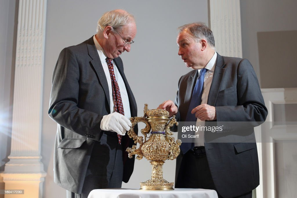 Director of the Ashmolean Museum Dr Christopher Brown (R) and Professor Timothy Wilson, The Keeper of the Ashmolean's Department of Western Art, discuss a 'silver gilt ewer with enamelled royal arms of Portugal' that dates from around 1510 AD in the Institute of Contemporary Arts, prior to an announcement of a major bequest of silver artifacts on January 31, 2013 in London, England. The Ashmolean has received a major collection of around 500 silver objects from the Renaissance and Baroque periods from the late silver merchant and expert Michael Wellby who died last year.
