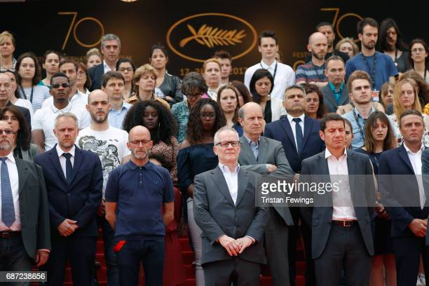 Director of the Cannes Film Festival Thierry Fremaux leads a minute of silence for the victims of the Manchester Terror Attack with other staff and...