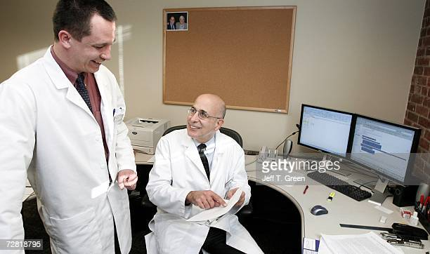 Director of the center Gregory Belenky MD and Hans Van Dongen PhD look over recent research data at Washington State University Spokane's Sleep and...