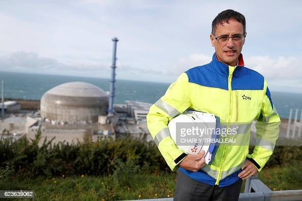 Director of the construction site Bertrand Michoud poses for a photograph above the European Pressurised Reactor project in Flamanville northwestern...