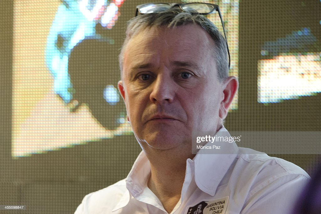 Director of the Dakar, <a gi-track='captionPersonalityLinkClicked' href=/galleries/search?phrase=Etienne+Lavigne&family=editorial&specificpeople=643127 ng-click='$event.stopPropagation()'>Etienne Lavigne</a> speaks during a press conference to present the 2014 Dakar Rally at Automovil Club Argentino on december 12, 2013 in Buenos Aires, Argentina. The race will be held in 2014 between the 5th and 18th of January.