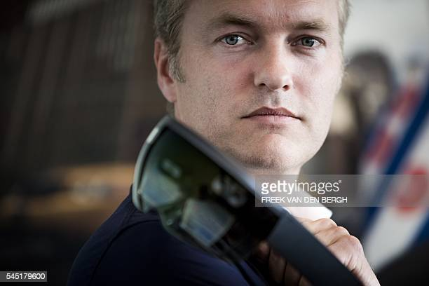 Director of the Dutch company Snakeware Ate van der Meer poses with the HoloLens the revolutionary mixedreality glass of Microsoft in Amsterdam on...