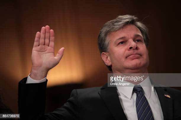 Director of the Federal Bureau of Investigation Christopher Wray listens is swornin during a Senate Committee on Homeland Security and Governmental...